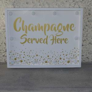 """Silt """"Champagne served here"""" LED-valgusega"""